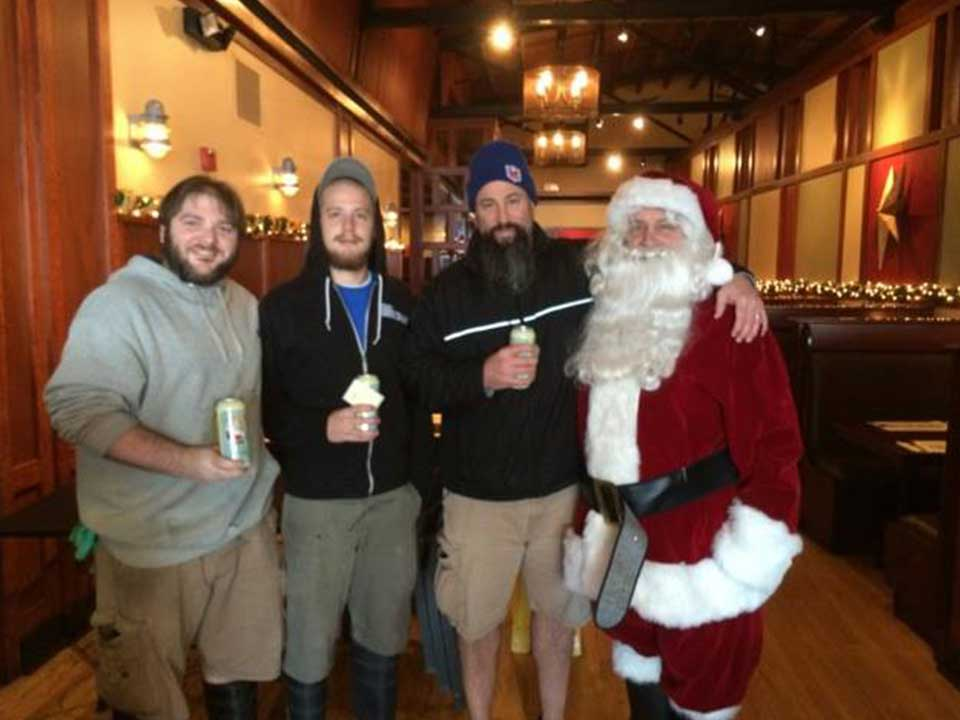 Iron Hill Owners Act as Santa Claus, Award Employees Appreciation Ale